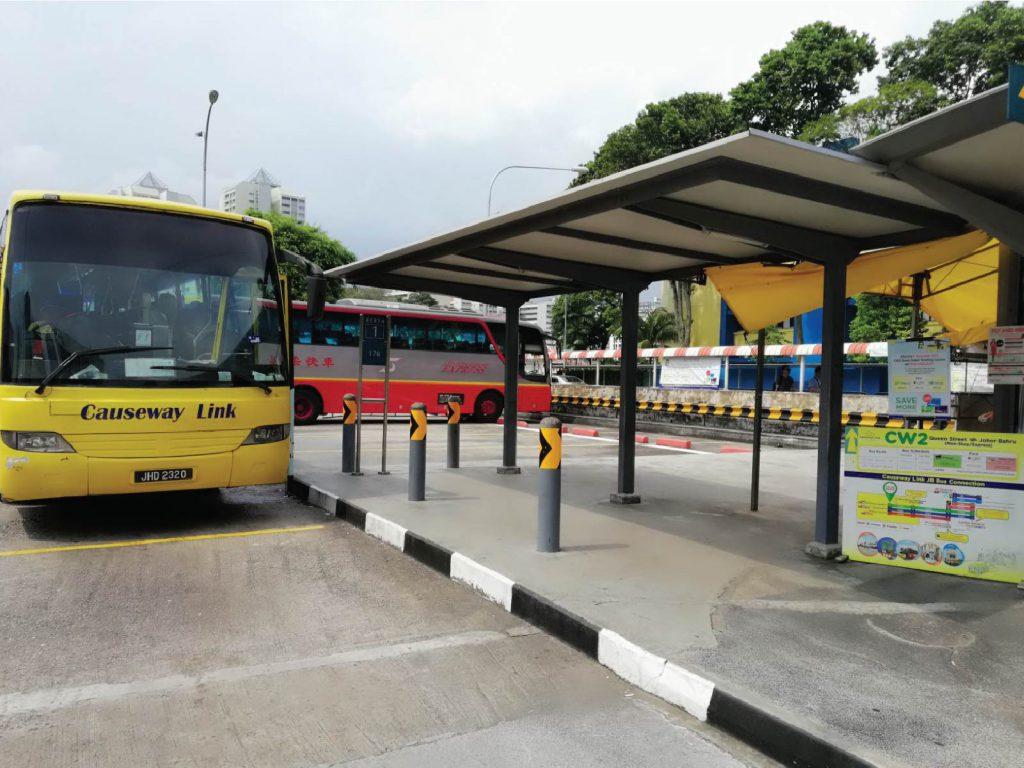 queen street in bugis with yellow smiling bus cw2